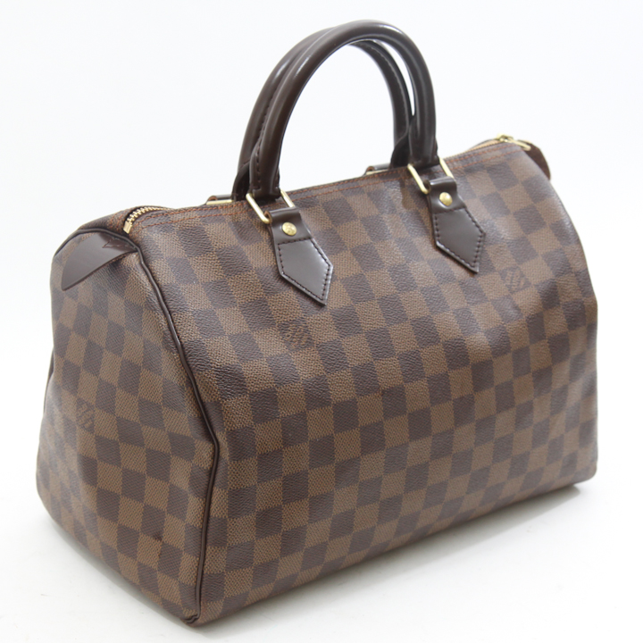 9f90a2cd72df Classic monogrammed coated canvas in size 30. Brand   Louis Vutton  Condition   7 10