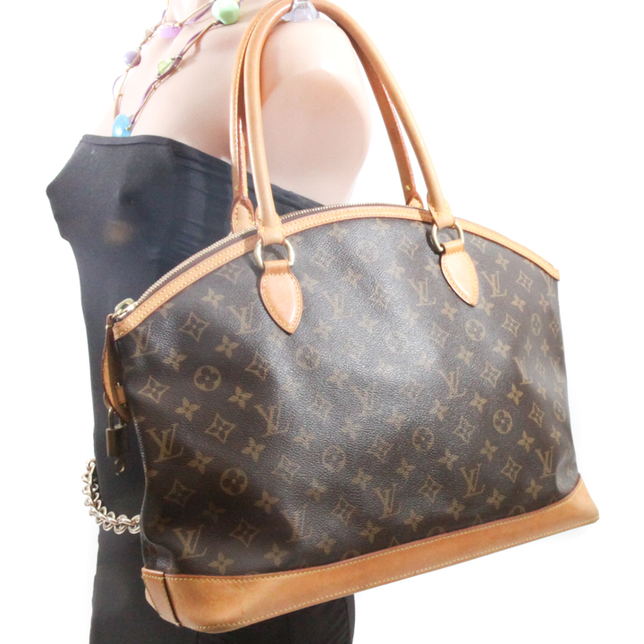 Sold - Louis Vuitton Black Suhali Lockit GM